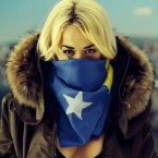 Now that's patriotism. Ora scarfed in Kosovo flag.