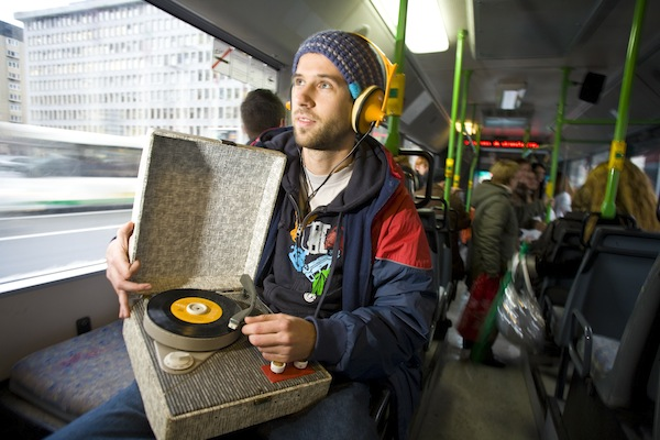 DJ Borka, listening to a retro iPod on a bus